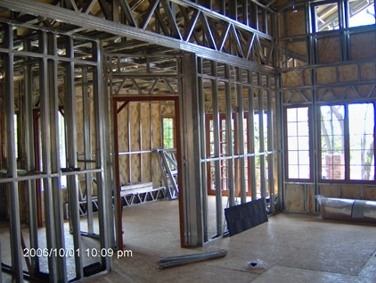Insulation blankets within light steel frame walls.